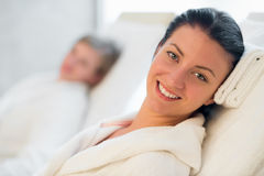 Smiling woman resting at beauty spa room Stock Images
