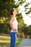 Smiling woman resting after exercise workout Stock Image