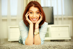 Smiling woman resting on the floor Royalty Free Stock Images