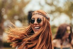 Smiling woman in retro look at music festival Stock Image