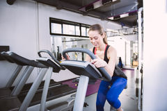 Smiling woman riding an exercise bike in gym Royalty Free Stock Photography