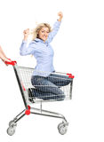 Smiling woman riding in a shopping cart Royalty Free Stock Photo
