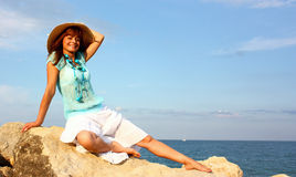 Smiling woman on rock Royalty Free Stock Photos