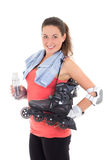 Smiling woman with roller skates Stock Image