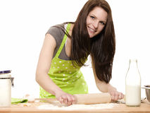 Smiling woman with rolling pin preparing dough Stock Photo