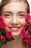 Smiling woman with roses Royalty Free Stock Photos