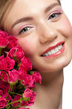 Smiling woman with roses Stock Photos