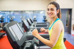 Smiling woman running on a treadmill Royalty Free Stock Photos