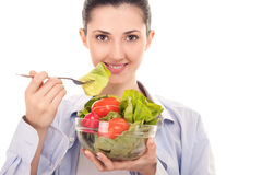 Smiling woman with salad Royalty Free Stock Photos