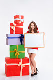 Smiling woman in santa claus cloth holding blank board Royalty Free Stock Photography