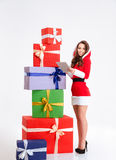 Smiling woman in santa claus cloth using tablet compter Stock Photo