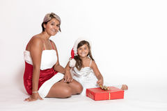Smiling woman in Santa costume and little girl royalty free stock photos