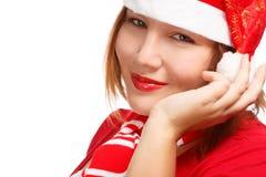 Smiling woman in santa hat Stock Image