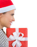 Smiling woman in Santa hat with Christmas gift box Stock Photo