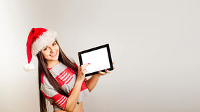 Smiling woman in santa hat Royalty Free Stock Images