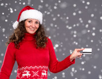 Smiling woman in santa hat credit card Stock Images