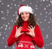 Smiling woman in santa hat credit card Royalty Free Stock Photography