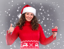 Smiling woman in santa hat credit card Royalty Free Stock Images