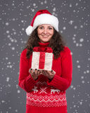 Smiling woman in santa  hat Stock Photography