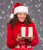 Smiling woman in santa hat with gift box Stock Images