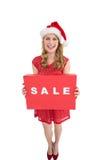 Smiling woman in santa hat holding box Stock Photos