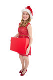 Smiling woman in santa hat holding box Royalty Free Stock Photography