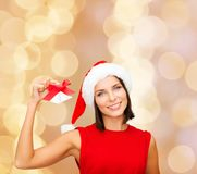Smiling woman in santa hat with jingle bells Стоковые Фотографии RF