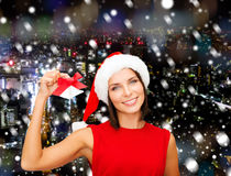 Smiling woman in santa hat with jingle bells стоковое изображение