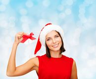 Smiling woman in santa hat with jingle bells Royalty Free Stock Photos