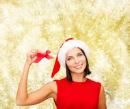 Smiling woman in santa hat with jingle bells Stock Photos