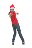 Smiling woman in Santa hat pointing in camera Stock Photography