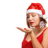 Smiling woman in santa hat with snowflakes Stock Images
