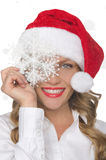 Smiling woman in Santa hat with snowflakes Royalty Free Stock Image