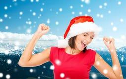 Smiling woman in santa helper hat Stock Photos