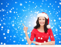 Smiling woman in santa helper hat Royalty Free Stock Image