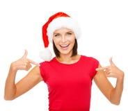 Smiling woman in santa helper hat Stock Image