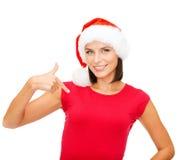 Smiling woman in santa helper hat Stock Images