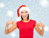 Smiling woman in santa helper hat Royalty Free Stock Photos