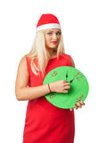 Smiling woman in santa helper hat with clock showing 12 Stock Photo