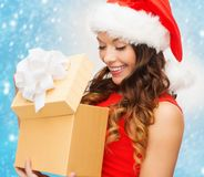 Smiling woman in santa helper hat with gift box stock photos