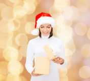 Smiling woman in santa helper hat with gift box. Christmas, winter, happiness, holidays and people concept - smiling woman in santa helper hat opening gift box Stock Photos