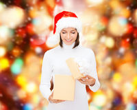 Smiling woman in santa helper hat with gift box Royalty Free Stock Images