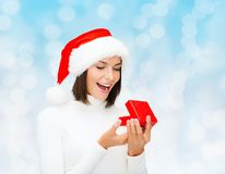 Smiling woman in santa helper hat with gift box Royalty Free Stock Photos