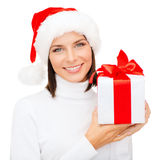 Smiling woman in santa helper hat with gift box Stock Photography