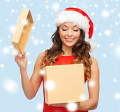 Smiling woman in santa helper hat with gift box Stock Images