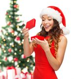 Smiling woman in santa helper hat with gift box Royalty Free Stock Photography