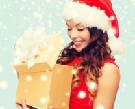 Smiling woman in santa helper hat with gift box Stock Image