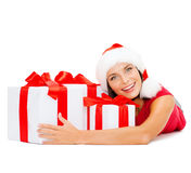 Smiling woman in santa helper hat with gift boxes Stock Photo