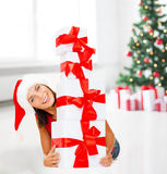 Smiling woman in santa helper hat with gift boxes Stock Photography