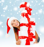 Smiling woman in santa helper hat with gift boxes Stock Image